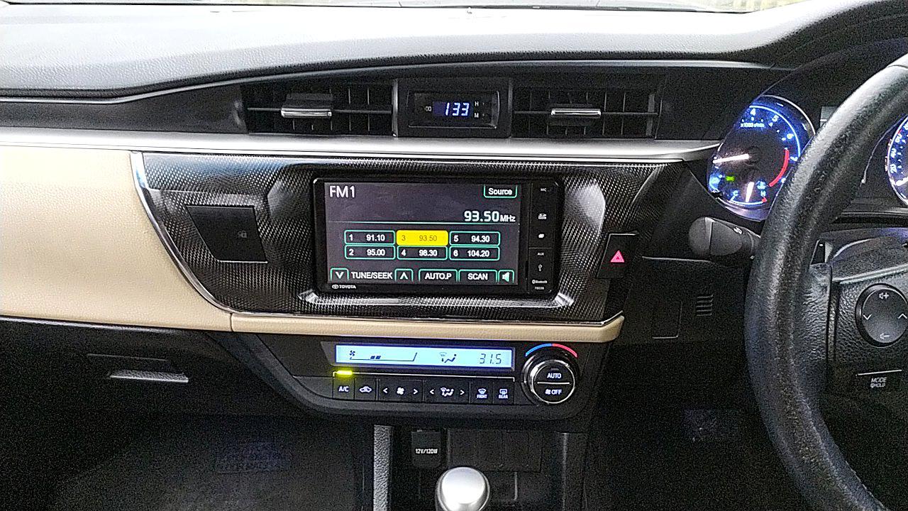 Spinny Assured Toyota Corolla Altis centre console