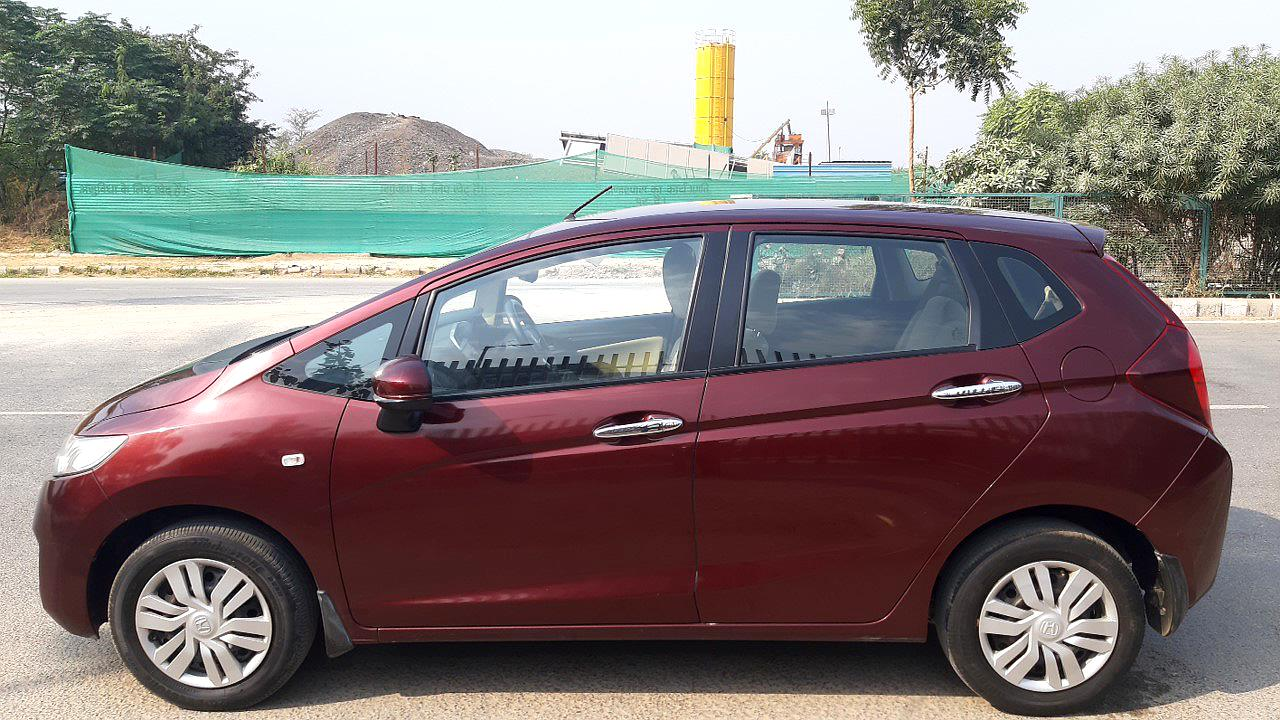 Spinny Assured Honda Jazz side