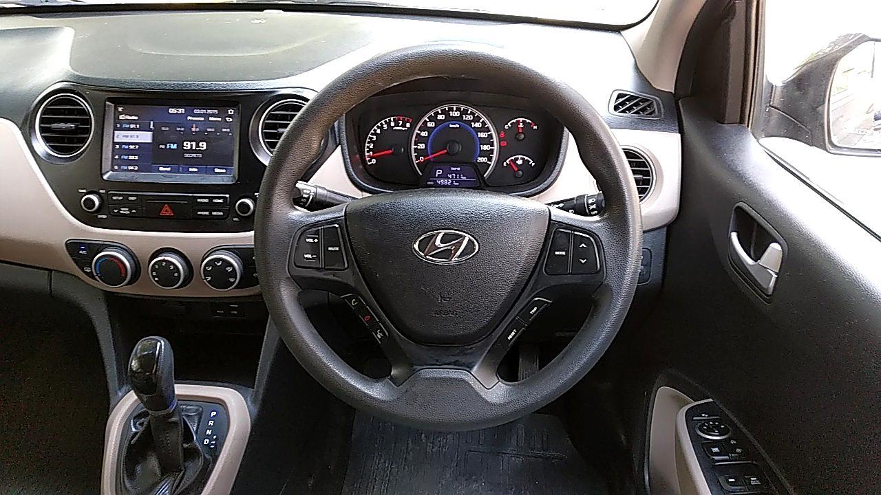 Spinny Assured Hyundai Grand i10 steering wheel