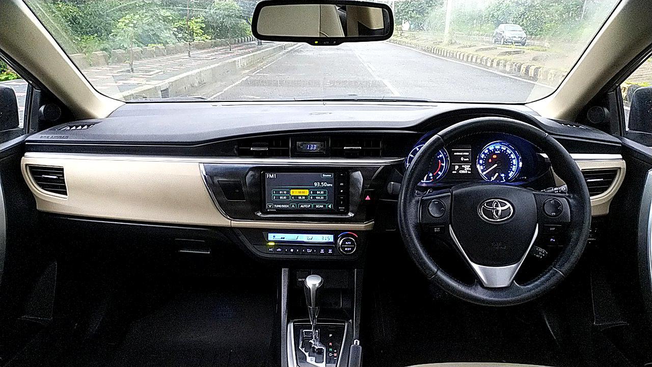 Spinny Assured Toyota Corolla Altis dashboard